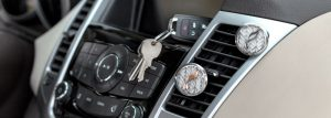 Car Vent Diffuser in car next next to your car keys.